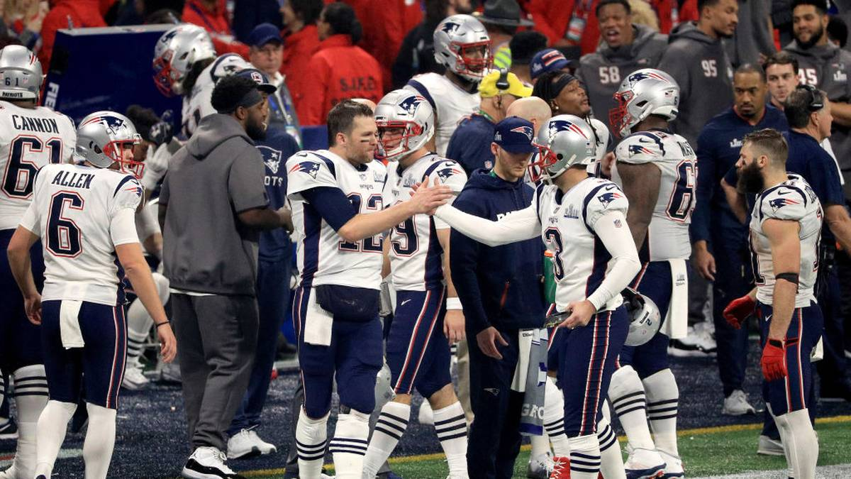 ATLANTA, GA - FEBRUARY 03: Tom Brady #12 of the New England Patriots high-fives Stephen Gostkowski #3 of the New England Patriots after Gostkowski made a field goal in the fourth quarter during Super Bowl LIII against the Los Angeles Rams at Mercedes-Benz Stadium on February 3, 2019 in Atlanta, Georgia.  (Photo by Mike Ehrmann/Getty Images)
