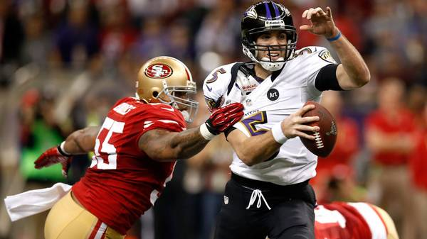 NEW ORLEANS, LA - FEBRUARY 03:  Joe Flacco #5 of the Baltimore Ravens attempts to escape a pass rush by Ahmad Brooks #55 of the San Francisco 49ers during Super Bowl XLVII at the Mercedes-Benz Superdome on February 3, 2013 in New Orleans, Louisiana. The Ravens won 34-31. (Photo by Chris Graythen/Getty Images)