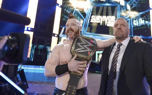 Der neue WWE Champion und sein Mentor: Sheamus (l.), mit WWE-Vizechef Triple H