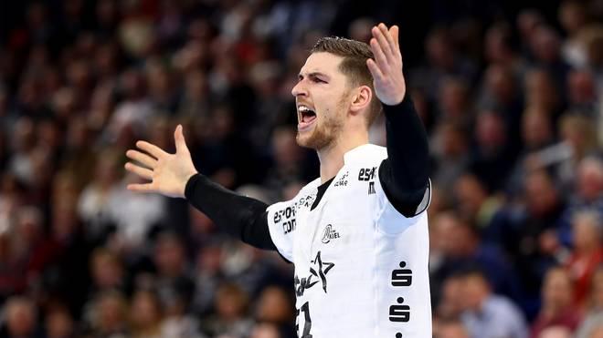 Henrik Pekeler feiert mit dem THW Kiel einen Sieg im Topspiel