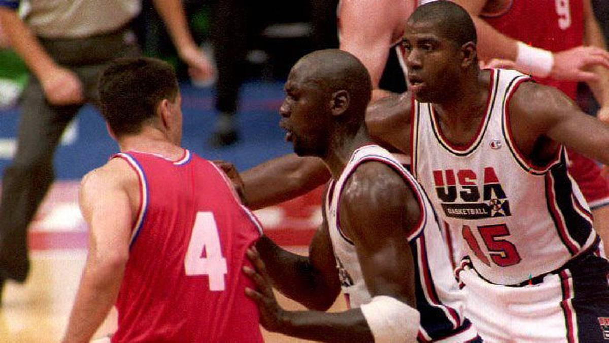 Croatian Drazen Petrovic (L) is guarded by U.S. Michael Jordan