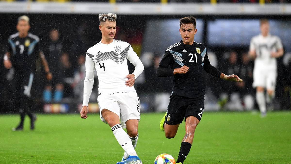 DORTMUND, GERMANY - OCTOBER 09: Robin Koch of Germany is closed down by Paulo Dybala of Argentina  during the International Friendly between Germany and Argentina at Signal Iduna Park on October 09, 2019 in Dortmund, Germany. (Photo by Jörg Schüler/Bongarts/Getty Images)