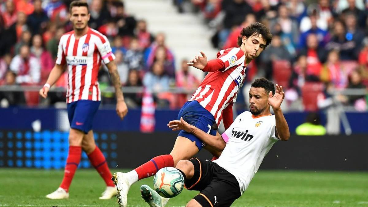 Atletico Madrid's Portuguese forward Joao Felix (R) vies with Valencia's French midfielder Francis Coquelin during the Spanish league football match Club Atletico de Madrid against Valencia CF at the Wanda Metropolitano stadium in Madrid on October 19, 2019. (Photo by PIERRE-PHILIPPE MARCOU / AFP) (Photo by PIERRE-PHILIPPE MARCOU/AFP via Getty Images)