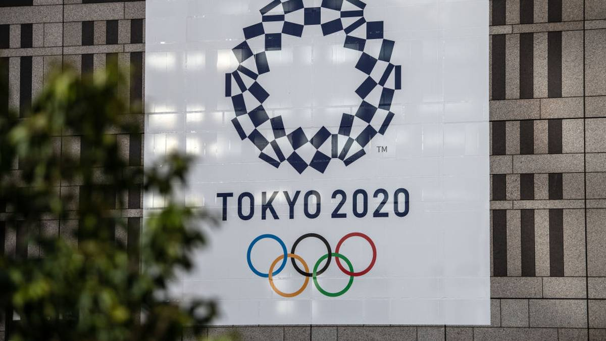 TOKYO, JAPAN - MARCH 19: A Tokyo 2020 Olympics banner is displayed on a building, on March 19, 2020 in Tokyo, Japan. As Japanese and IOC officials continued to insist that the Games would go ahead as planned, Japans Deputy Prime Minister said on Wednesday that the Tokyo Olympics are cursed, as speculation grows that the Olympics will have to be postponed due to the ongoing coronavirus (COVID-19) pandemic. (Photo by Carl Court/Getty Images)