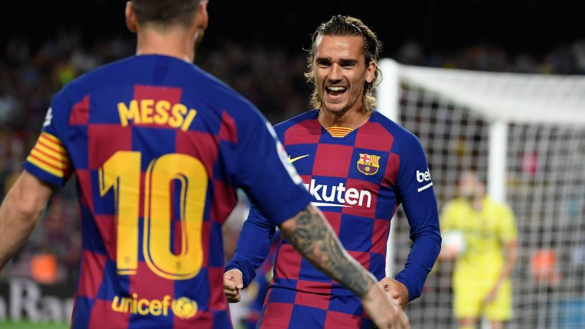 Barcelona's French forward Antoine Griezmann (R) is congratulated by teammate Barcelona's Argentine forward Lionel Messi after scoring the first goal during the Spanish league football match between FC Barcelona and Villarreal CF at the Camp Nou stadium in Barcelona, on September 24, 2019. (Photo by LLUIS GENE / AFP)        (Photo credit should read LLUIS GENE/AFP/Getty Images)