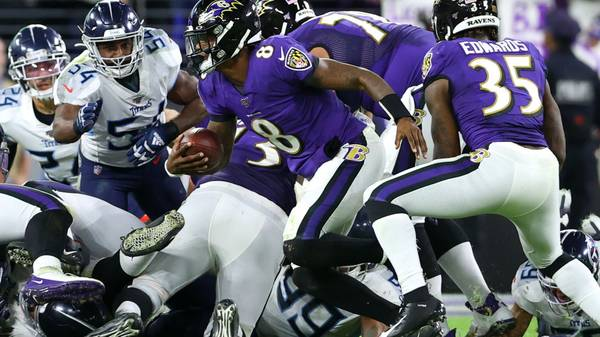 BALTIMORE, MARYLAND - JANUARY 11: Quarterback Lamar Jackson #8 of the Baltimore Ravens is stopped short by the Tennessee Titans defense on fourth down in the second half during the AFC Divisional Playoff game at M&T Bank Stadium on January 11, 2020 in Baltimore, Maryland. (Photo by Rob Carr/Getty Images)