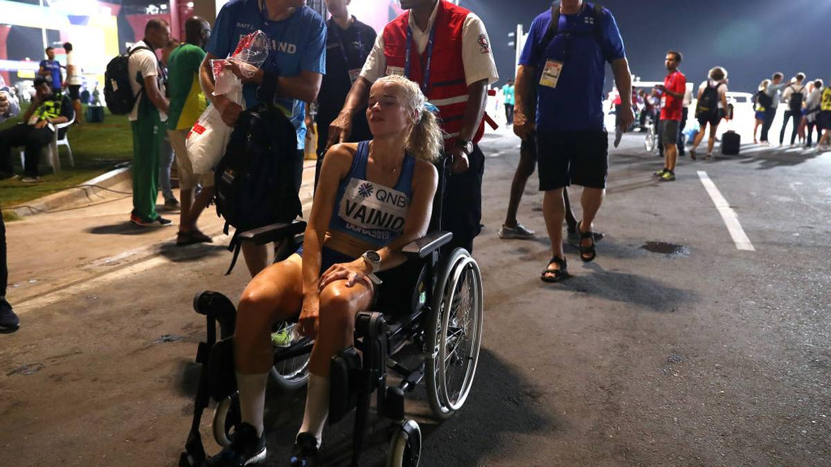 DOHA, QATAR - SEPTEMBER 27: Alisa Vainio of Finland is taken off on a wheelchair after the Women's Marathon on day one of 17th IAAF World Athletics Championships Doha 2019 at Khalifa International Stadium on September 27, 2019 in Doha, Qatar. (Photo by Alexander Hassenstein/Getty Images for IAAF)