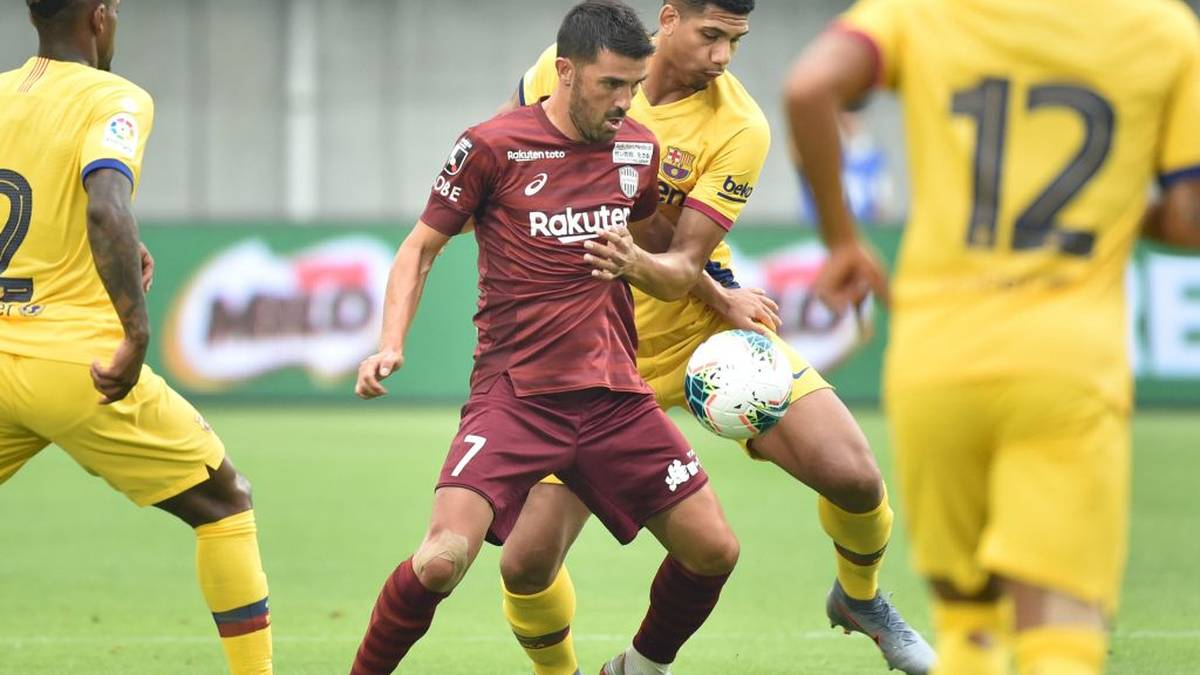 Vissel Kobe's forward David Villa (C) is surrounded by players of FC Barcelona during the Rakuten Cup football match between Vissel Kobe and FC Barcelona, in Kobe on July 27, 2019. (Photo by Kazuhiro NOGI / AFP)        (Photo credit should read KAZUHIRO NOGI/AFP via Getty Images)