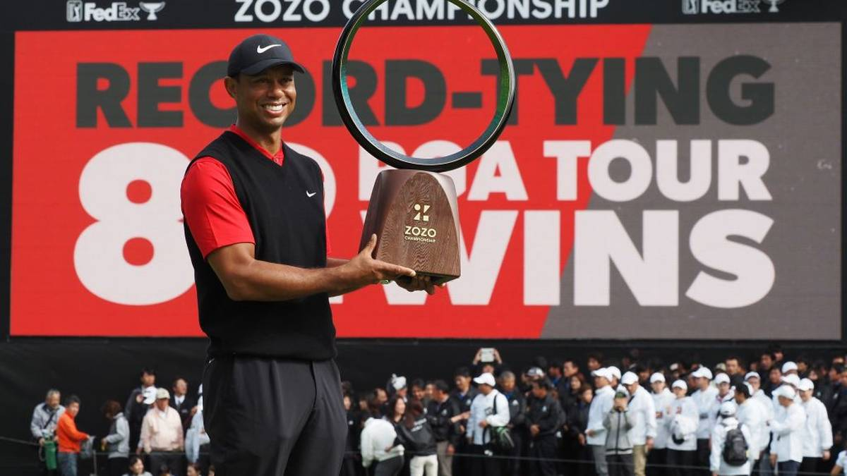 Tiger Woods of the US holds a victory trophy during the awarding ceremony of the PGA ZOZO Championship golf tournament at the Narashino Country Club in Inzai, Chiba prefecture on October 28, 2019. (Photo by TOSHIFUMI KITAMURA / AFP) (Photo by TOSHIFUMI KITAMURA/AFP via Getty Images)