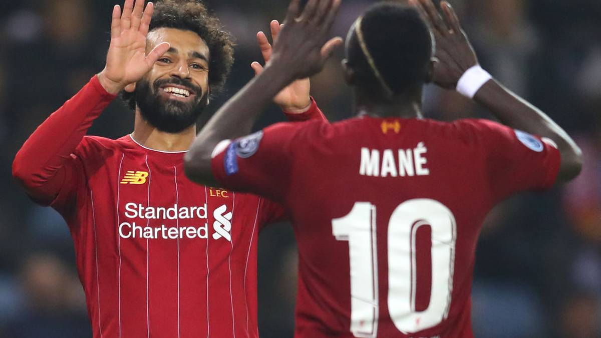 GENK, BELGIUM - OCTOBER 23: Mohamed Salah of Liverpool celebrates with teammate Sadio Mane after scoring his team's fourth goal during the UEFA Champions League group E match between KRC Genk and Liverpool FC at Luminus Arena on October 23, 2019 in Genk, Belgium. (Photo by Catherine Ivill/Getty Images)