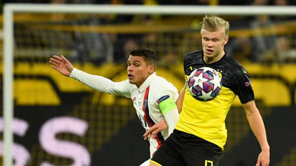 Dortmund's Norwegian forward Erling Braut Haaland (R) vies for the ball with Paris Saint-Germain's Brazilian defender Thiago Silva during the UEFA Champions League Last 16, first-leg football match BVB Borussia Dortmund v Paris Saint-Germain (PSG) in Dortmund, western Germany, on February 18, 2020. (Photo by Ina Fassbender / AFP) (Photo by INA FASSBENDER/AFP via Getty Images)