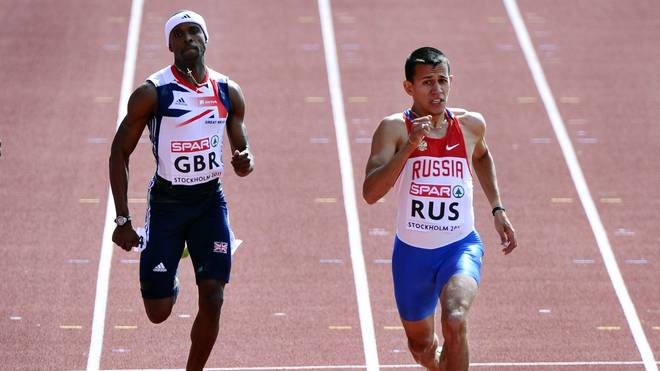Maksim Dyldin of Russia (R) competes to