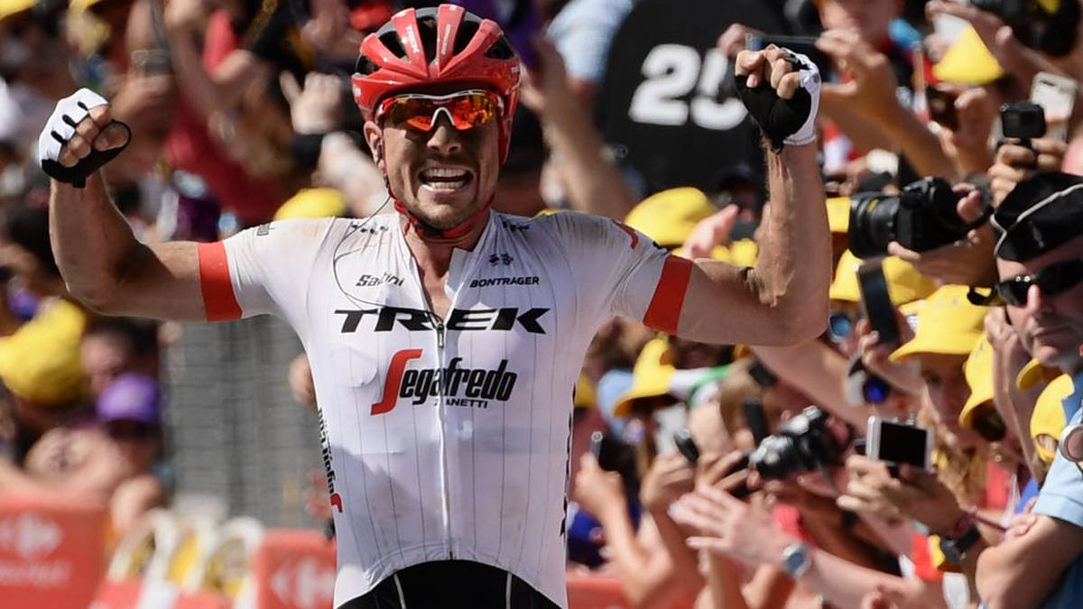 Germany's John Degenkolb celebrates as he crosses the finish line to win the ninth stage of the 105th edition of the Tour de France cycling race between Arras and Roubaix, northern France, on July 15, 2018. (Photo by Philippe LOPEZ / AFP)        (Photo credit should read PHILIPPE LOPEZ/AFP/Getty Images)