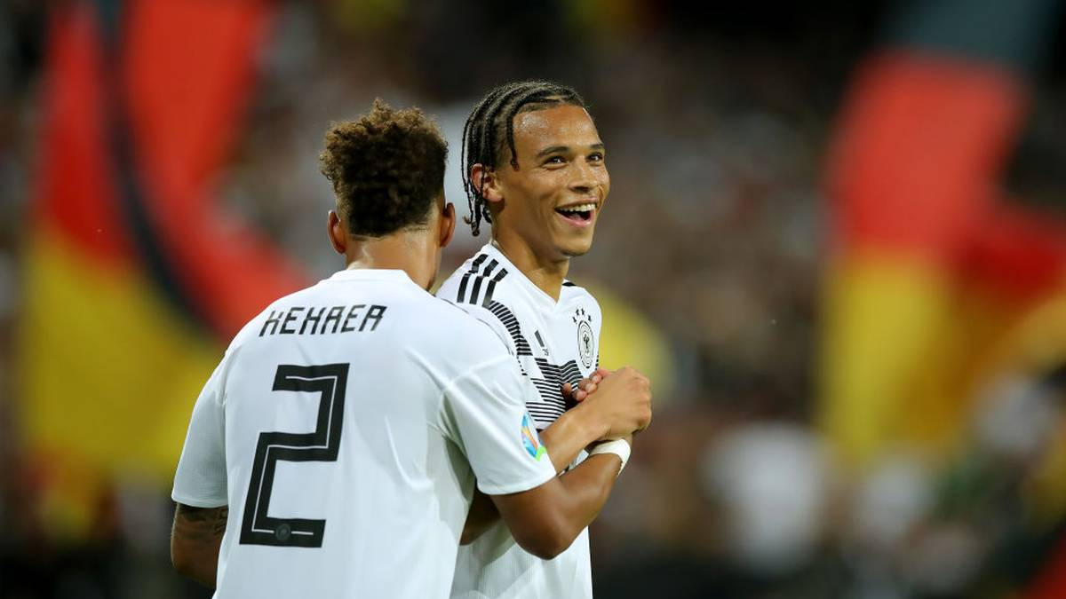 MAINZ, GERMANY - JUNE 11: Leroy Sane (L) of Germany celebrates scoring the 8th goal with team mate Thilo Kehrer during the UEFA Euro 2020 Qualifier match between Germany and Estonia at Opel Arena on June 11, 2019 in Mainz, Germany. (Photo by Alexander Hassenstein/Bongarts/Getty Images)