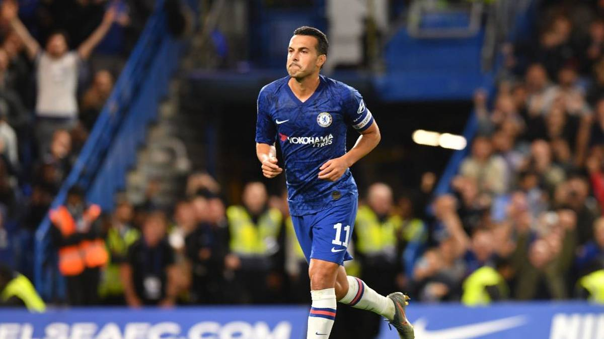 Chelsea's Spanish midfielder Pedro celebrates scoring his team's third goal during the English League Cup third round football match between Chelsea and Grimsby Town at Stamford Bridge in south west London, on September 25, 2019. (Photo by OLLY GREENWOOD / AFP) / RESTRICTED TO EDITORIAL USE. No use with unauthorized audio, video, data, fixture lists, club/league logos or 'live' services. Online in-match use limited to 120 images. An additional 40 images may be used in extra time. No video emulation. Social media in-match use limited to 120 images. An additional 40 images may be used in extra time. No use in betting publications, games or single club/league/player publications. /         (Photo credit should read OLLY GREENWOOD/AFP via Getty Images)