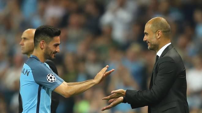 Ilkay Gündogan und Pep Guardiola von Manchester City