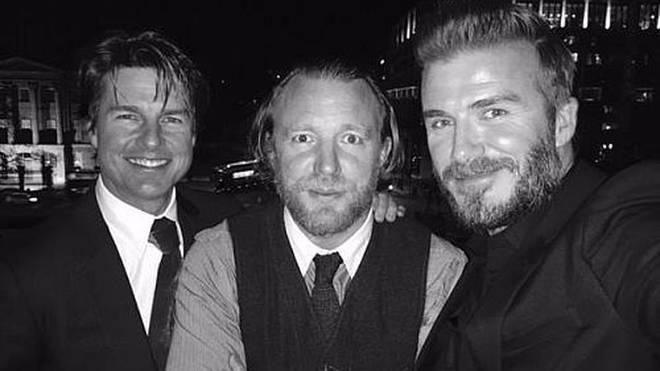 David Beckham posiert mit Tom Cruise und Guy Ritchie.