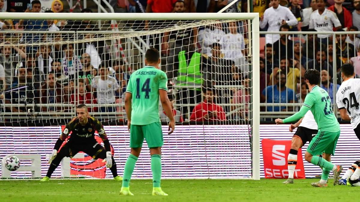 Real Madrid's Spanish midfielder Isco (R) scores past Valencia's Spanish goalkeeper Jaume Domenech (L) during the Spanish Super Cup semi final between Valencia and Real Madrid on January 8, 2020, at the King Abdullah Sport City in the Saudi Arabian port city of Jeddah. (Photo by GIUSEPPE CACACE / AFP) (Photo by GIUSEPPE CACACE/AFP via Getty Images)