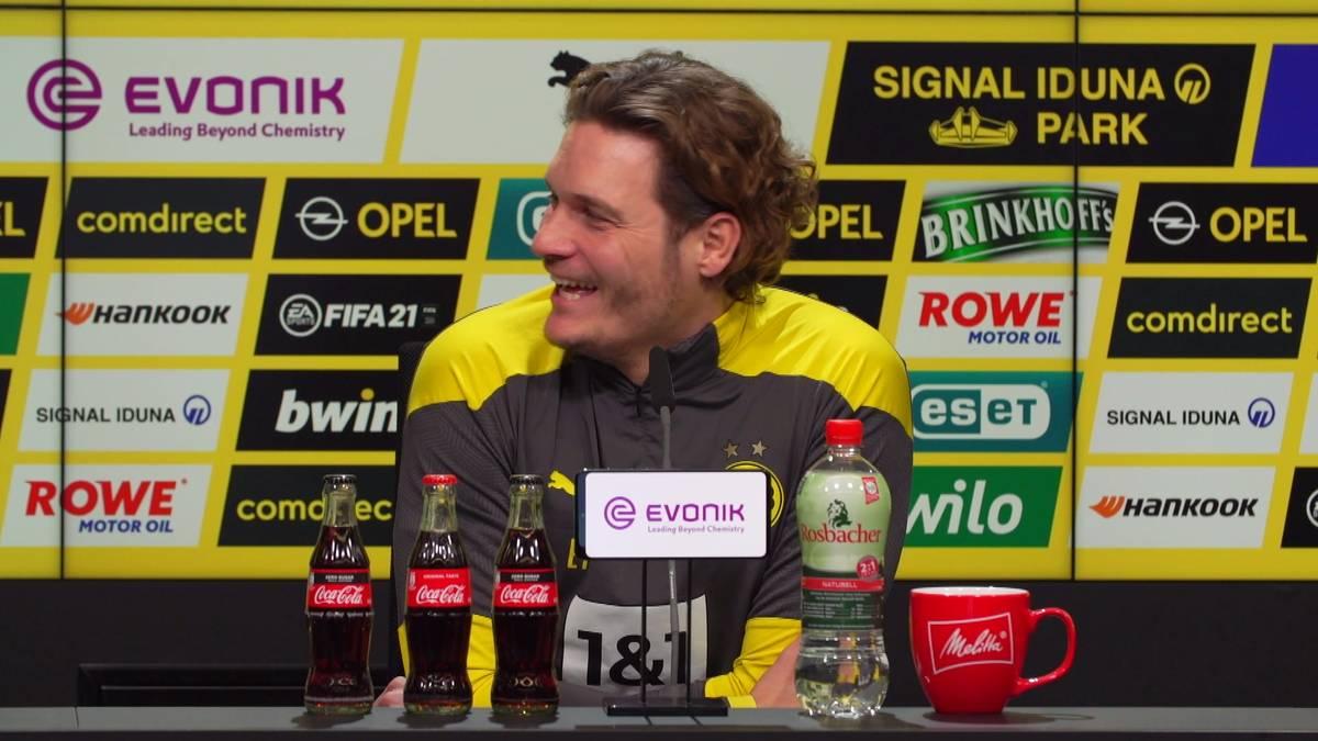 """Bei der Zoom-Pressekonferenz des BVB kommt es zu einer kuriosen """"Störung"""": Ein Wellensittich macht während der Frage eine Reporters im Hintergrund mächtig auf sich aufmerksam."""
