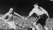 Blackpool's forward Stanley Matthews (L) dribbles