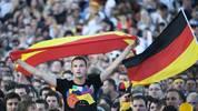 A fan of the Spain's football team cheer