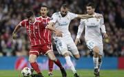 Karim Benzema (M., gegen Robert Lewandowski) wurde den Bayern im Tausch mit dem Polen angeboten