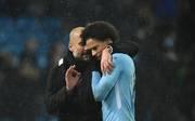 Pep Guardiola (l.) ist derzeit mit Leroy Sane hochzufrieden