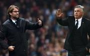 Jürgen Klopp (l.) trifft am Mittwoch mit dem FC Liverpool auf Carlo Ancelotti und den SSC Neapel
