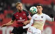 Der 1. FC Nürnberg (l.: Hanno Behrens) muss zum Derby nach Ingolstadt