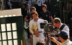 Switzerland's Roger Federer is filmed by