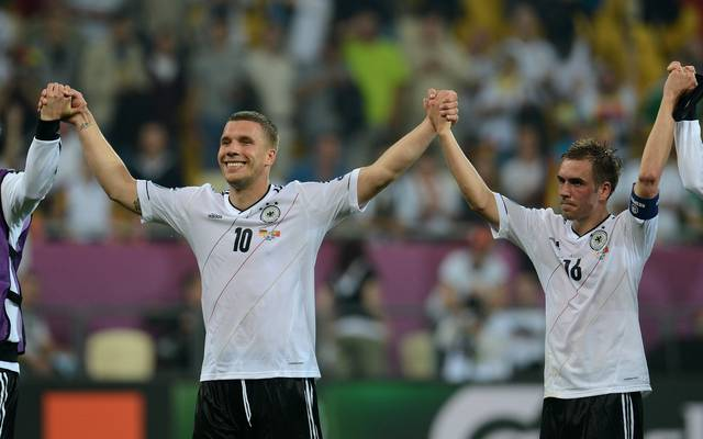 German forward Lukas Podolski (L) and Ge