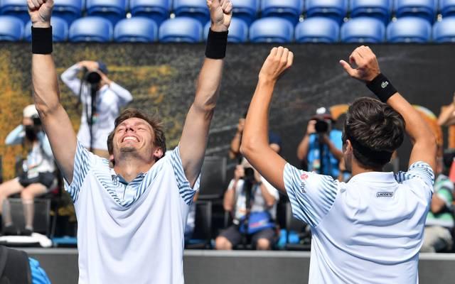 Pierre-Hugues Herbert (r.) und Nicolas Mahut haben auch im vierten Major den Titel geholt