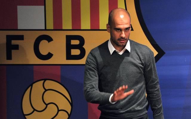 Barcelona's coach Josep Guardiola gives