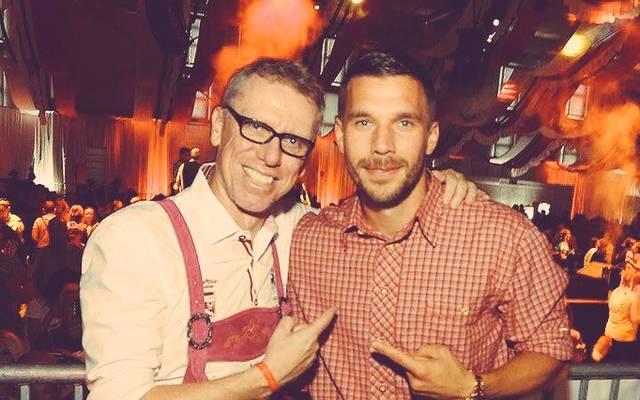 Lukas Podolski (r.) und Peter Stöger (l.)