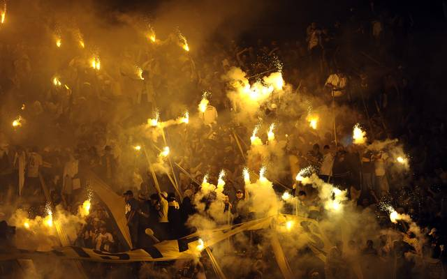 Supporters of Boca Juniors light flares