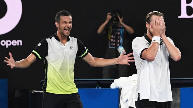 Mate Pavic (l.) und Oliver Marach freuen sich über den Doppel-Titel