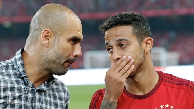 Thiago (r.) bleibt bis 2019 beim FC Bayern