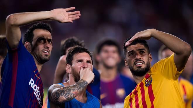 Sergio Busquets (l.) steht beim FC Barcelona bis 2021 unter Vertrag