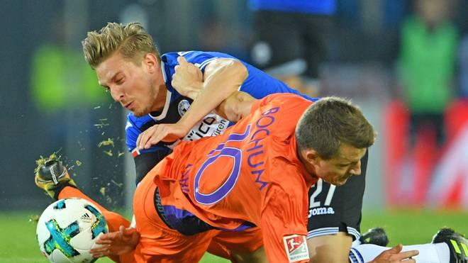 Der VfL Bochum (r.: Thomas Eisfeld) und Arminia Bielefled (l.: Konstantin Kerschbaumer) beschließen den 20. Spieltag